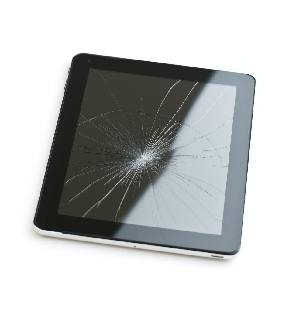 Tablet computer with broken screen.
